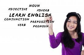 picture of verbs  - Image of a beautiful and smart teenage girl learns english and write the english materials on the whiteboard - JPG