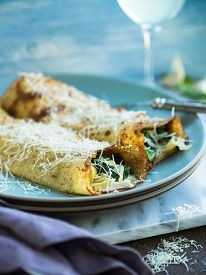 stock photo of crepes  - Breakfast crepes with eggs spinach and bechamel sauce