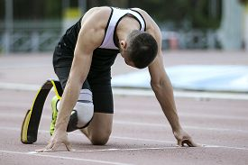stock photo of handicapped  - The handicap athlete preparing to start running - JPG