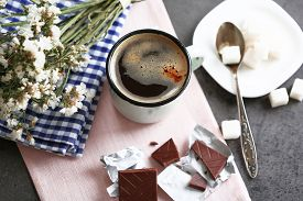 image of flavor  - Cup of flavored coffee with chocolate on table with napkin - JPG