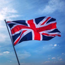 image of british culture  - british flag on sky background - JPG