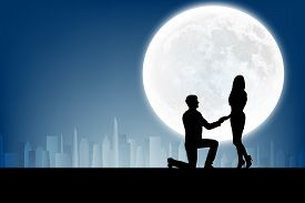 stock photo of moon silhouette  - silhouette of man makes a proposal a silhouette woman on the full moon background - JPG