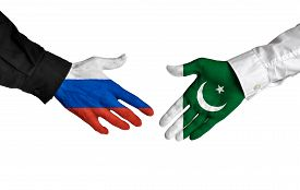 stock photo of pakistani flag  - Diplomatic handshake between leaders from Russia and Pakistan with flag - JPG