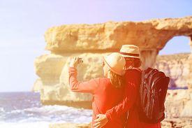 stock photo of gozo  - Tourist couple making selfie photo on Azure Window in Gozo island - JPG