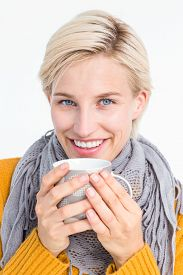 foto of feeling better  - Close up of woman drinking from a cup to feel better - JPG