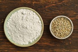 stock photo of oats  - Oats and oat flour in small bowls from above - JPG