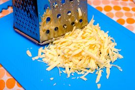 foto of grating  - Grated tasty cheese with a blue plaque in Russian cuisine - JPG