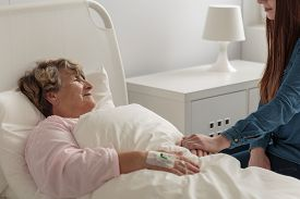 picture of grandma  - Girl caring about caring grandma staying in hospital - JPG