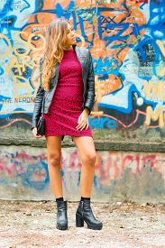 foto of mural  - Beautiful young girl with black leather jacket in front of a colorful mural and wall - JPG