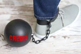 picture of ball chain  - In slavery of credit concept with metal ball on chain and leg - JPG