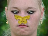 Girl With Utterfly On Nose
