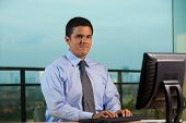 Latino Businessman Working Looking At Camera Horizontal