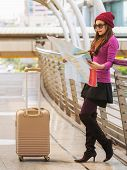 Woman Traveller Looking At Travel Map poster