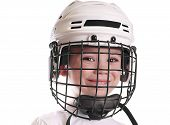 Boy in hockey helmet