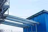 Fragment Metal Grain Elevator In Agricultural Zone. Agricultural Silos. Building Exterior. Storage A poster