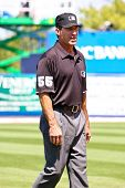 PORT ST. LUCIE, FLORIDA - MARCH 23: Baseball umpire Angel Hernandez walks along third base during a