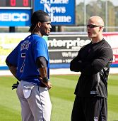 PORT ST. LUCIE, FLORIDA - MARCH 24: NY Mets shortstop Jose Reyes (L) chats with team physical therap