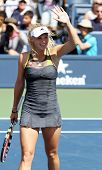 FLUSHING, NY - SEPTEMBER 4: Caroline Wozniacki waves after winning womens singles at the US Open Tennis Tournament at the Billie Jean National Tennis Center on September 4, 2010 in  Flushing, NY.
