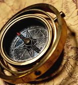 Vintage compass on the old map