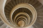 stock photo of spiral staircase  - A spiral staircase inside a tower looking down - JPG