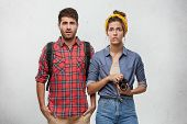 Traveling, Tourism And Traveling Concept. Picture Of Unhappy Young Caucasian Man And Woman With Ruck poster