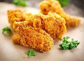 Fried chicken wings on wooden table. Breaded Crispy fried kentucky chicken tasty dinner. Deep fried  poster