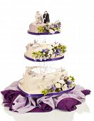 Heart shaped wedding cake in three tiers with flowers and butterflies made from sugar icing on white
