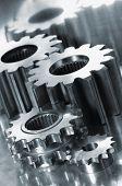 large gear-machinery against shiny titanium
