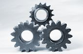 three metallic-blue gears, isolated on white, ideal for cut-outs