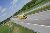 yellow truck in country-side highway, panoramic-view