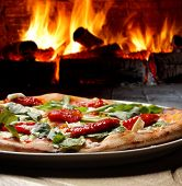 stock photo of hot fresh pizza  - pizza oven - JPG