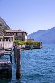 Cute Idyllic Italian Village And Lake Captured From The Water. Limone At Lago Di Garda. poster