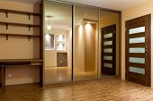 Modern apartment interior with huge wardrobe