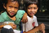 image of peddlers  - Cambodian boys selling postcards at Bayon Temple - JPG