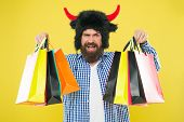 Wild About Shopping. Man Strict Face Wear Hat Of Bull With Horns. Hipster Shopping Addicted Or Shopa poster