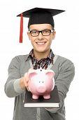 Student holding piggy bank