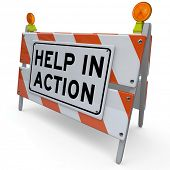 A construction barricade with the words Help in Action to alert you to a project in which others are