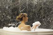 Beautiful Young Woman Taking Foam Bath