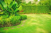 Garden In Spring, Pathways With Green Lawns, Landscaping In The Garden, Curve Walkway On Green Grass poster