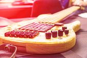 Modern Electric Six-string Bass Guitar. Toned Photo. Selective Focus poster