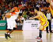 KUALA LUMPUR - FEBRUARY 19: Malaysian Dragons' Tiras Wade (white) dribbles in at the ASEAN Basketbal