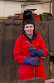 Smiling Welder With Safety Visor And Torch