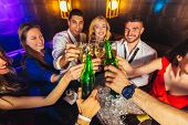 Group Of Friends Partying In A Nightclub And Toasting Drinks. poster