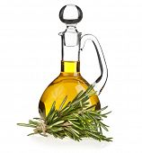 decanter with rosemary  oil isolated on white background
