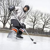 Boy Playing Ice Hockey.