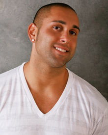 foto of shaved head  - Photo of a smiling and casual attractive man - JPG