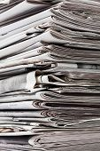 stock photo of reprocess  - Detailed image of a stack of old newspaper for recycling - JPG