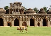 stock photo of vijayanagara  - Elephant stables at the Cacred Center of Vijayanagara at Hampi a city located in Karnataka South West India - JPG