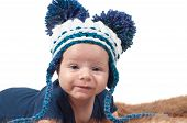 stock photo of pon  - Cute baby in knitted hat with big pom - JPG