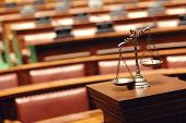 stock photo of courtroom  - Symbol of law and justice in the empty courtroom law and justice concept - JPG